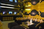 Basement TV room at Graceland decorated in yellow and blue.