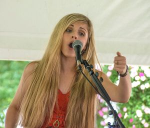 Peyton Taylor singing at the Fair