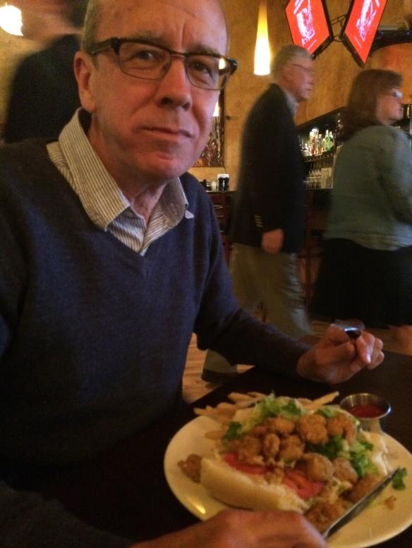 Si with his Po' Boy shrimp sandwich!