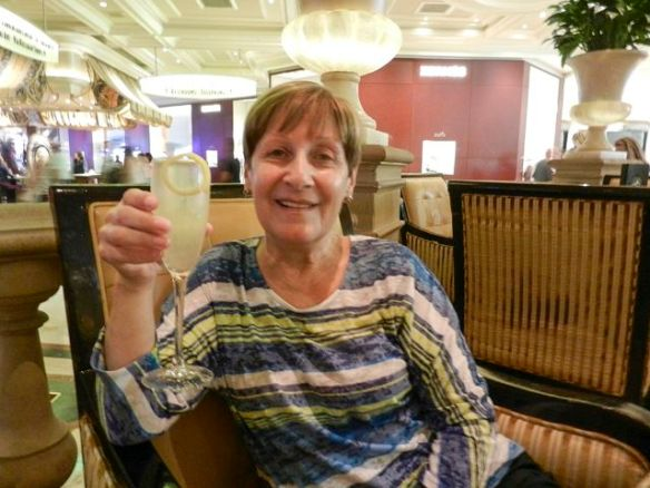 Sand enjoying her French 75 at the Petrossian Bar