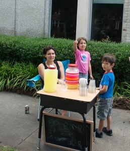 Michelle, Lila and Rafi selling their homemade lemonade!
